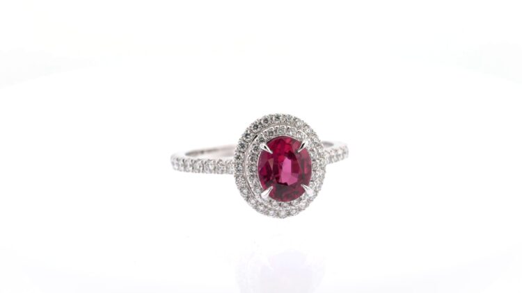 exceptional oval ruby and white diamond double halo ring
