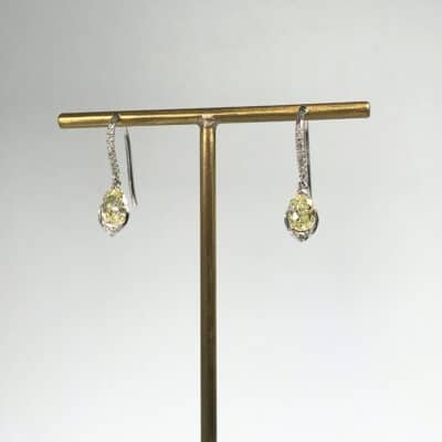 elegant yellow diamond earrings with diamond detail