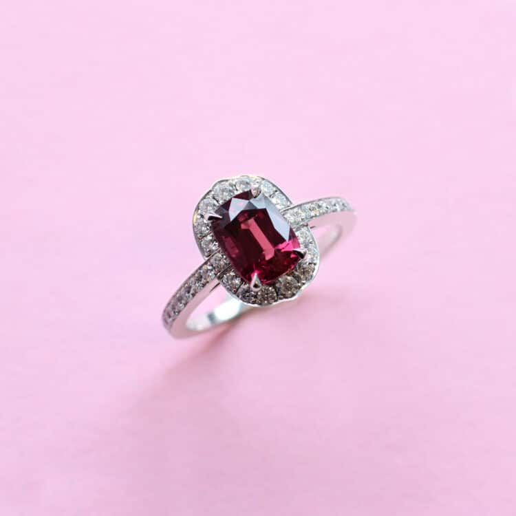 deep red ruby and white diamond halo ring