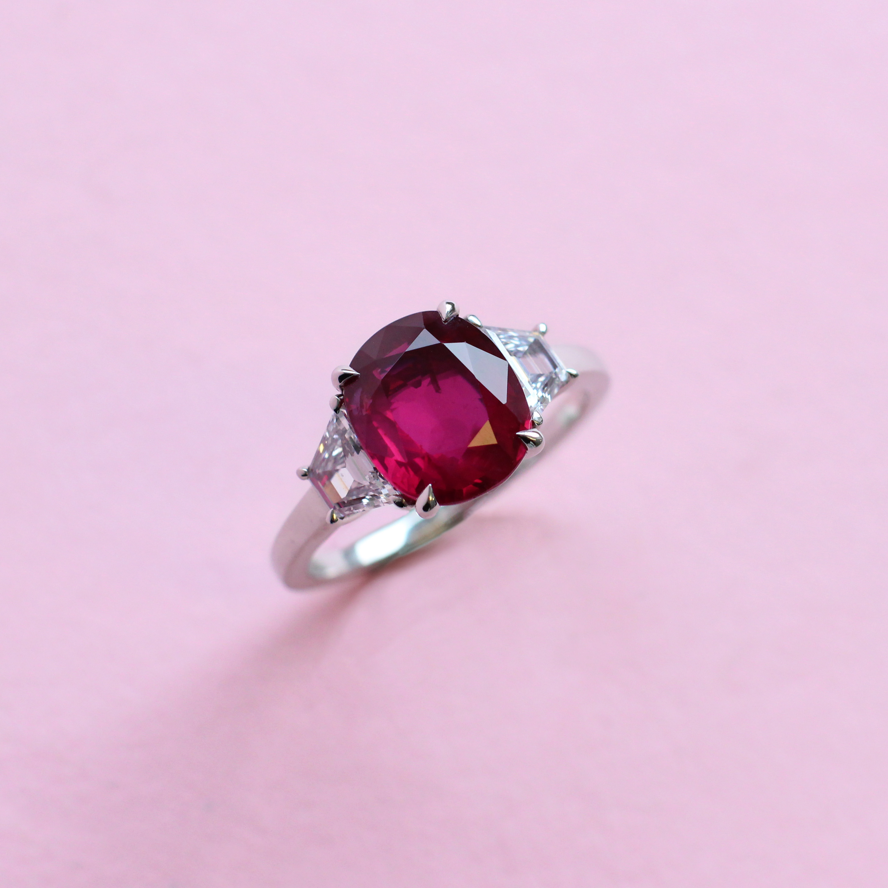 oval ruby and diamond trilogy ring
