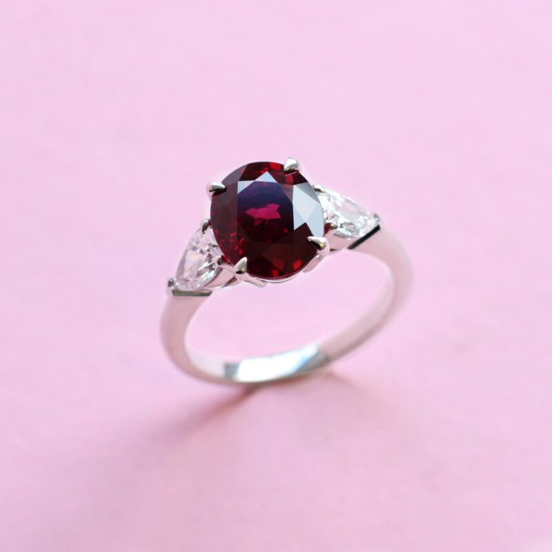vivid red ruby ring with white diamonds on platinum