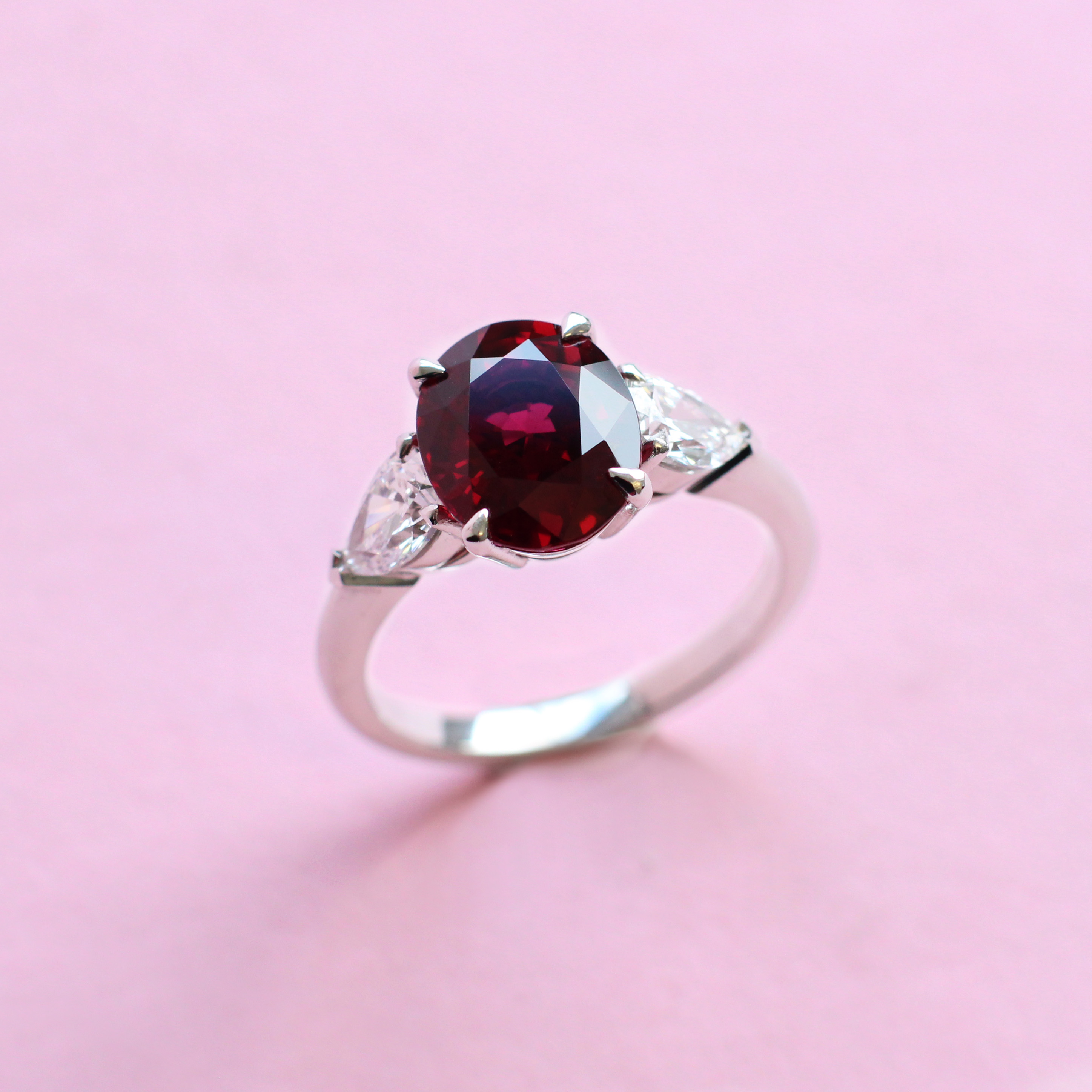 oval ruby and diamond three stone ring
