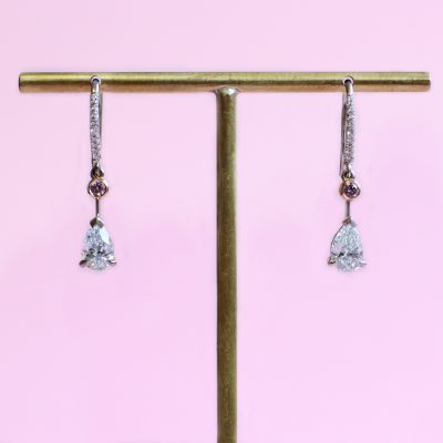 white and pink diamond earrings
