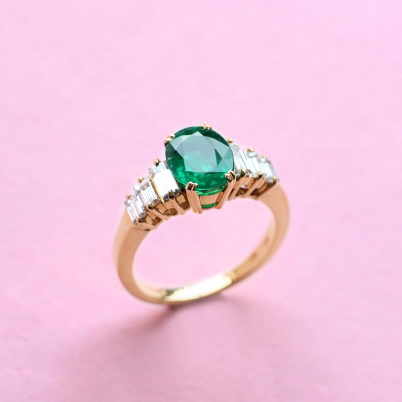 spectacular emerald ring with baguette diamond detail