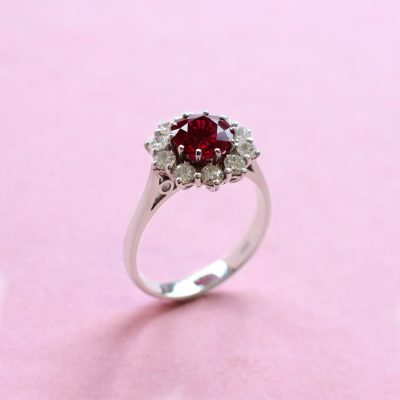 round ruby, white diamond surround and white gold ring