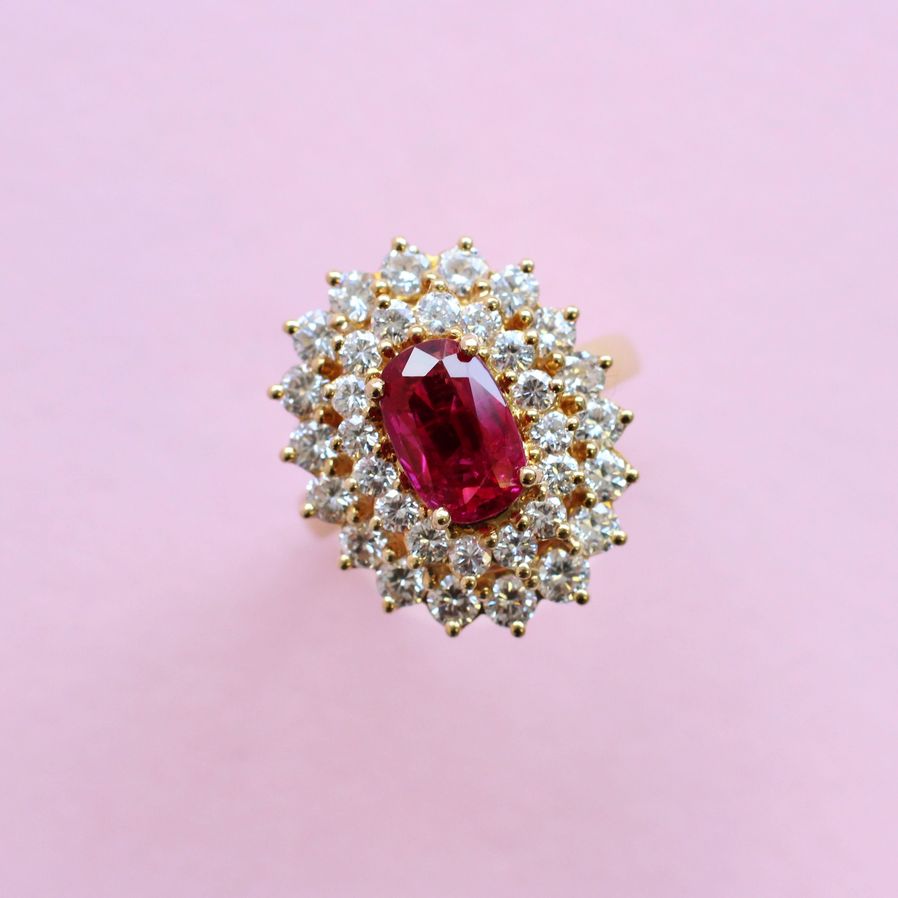 vintage style oval ruby and diamond cluster ring