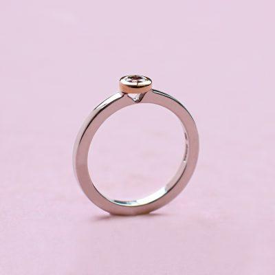 pink round diamond, white and rose gold stacking ring