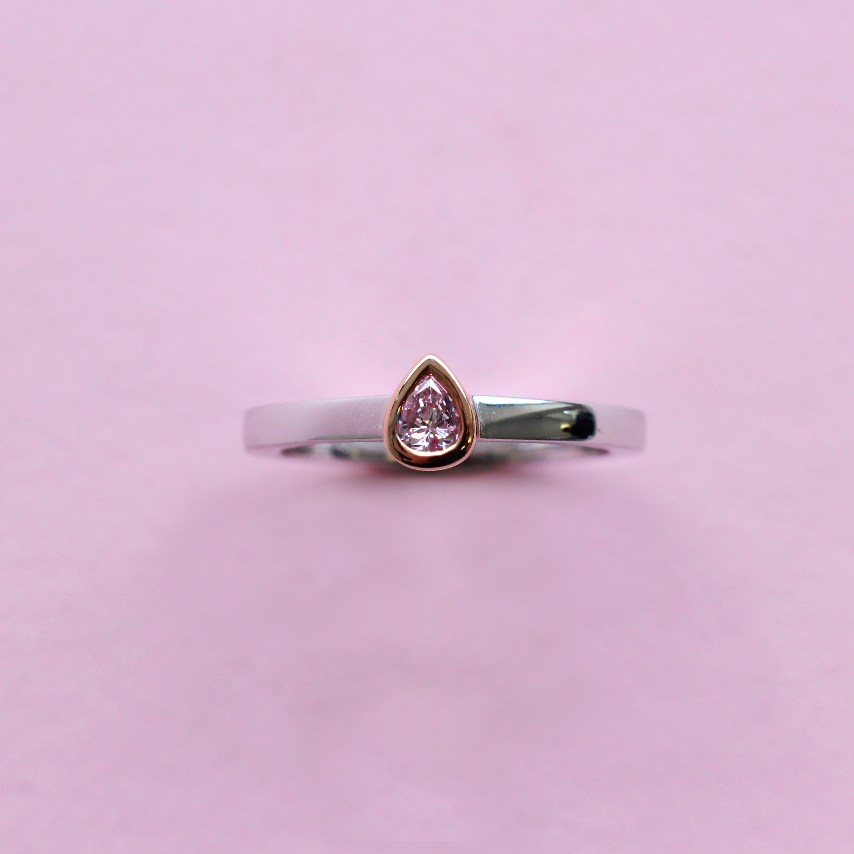 pink pear shape diamond, white and rose gold stacking ring