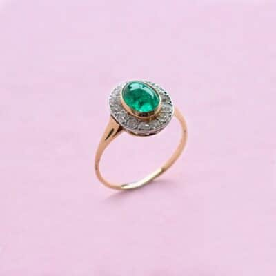 cabochon emerald ring with striking white diamond surround