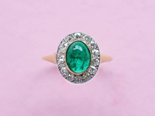 emerald cabochon and diamond cluster ring