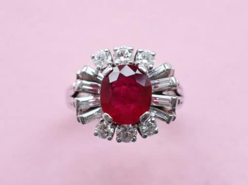 oval ruby and diamond surround ring