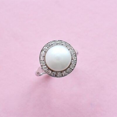 unique pearl and white diamond vintage-style platinum ring