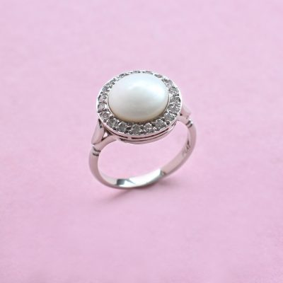 pearl, diamond surround and platinum ring
