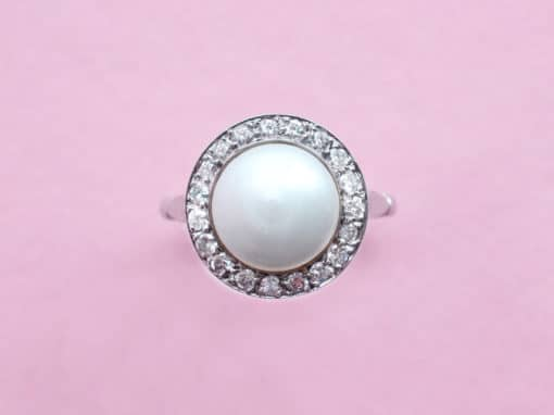pearl, diamond surround and platinum ring