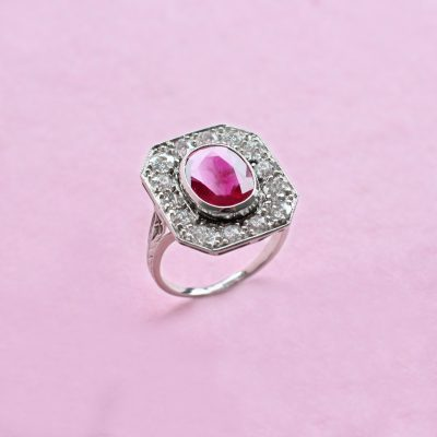 oval ruby with diamond surround ring