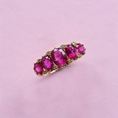 oval ruby five stone ring