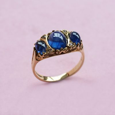 sapphire cabochon three stone ring