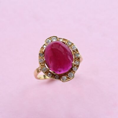 sensational pinkish red ruby ring with white diamond halo