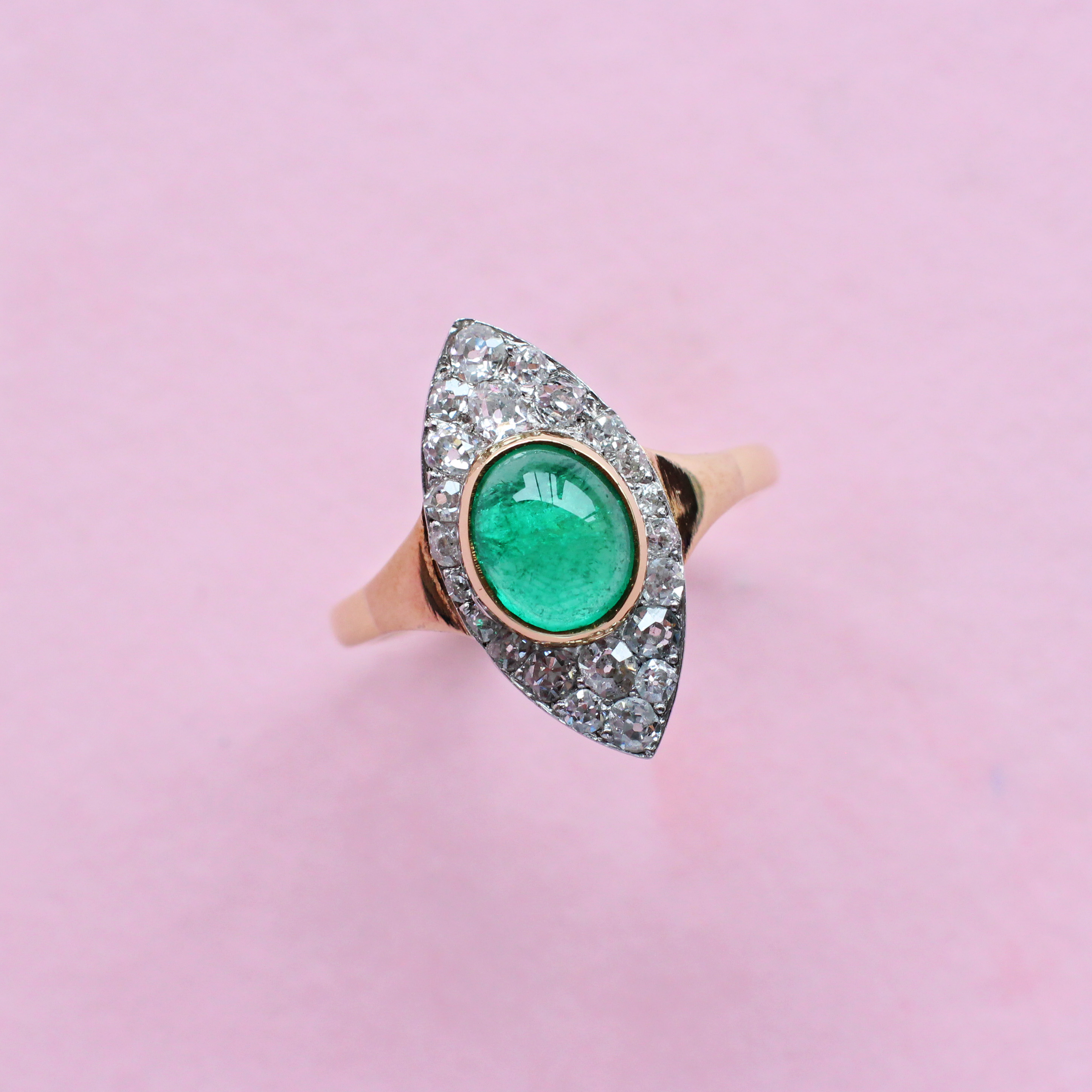 vintage style emerald and diamond cluster marquise ring