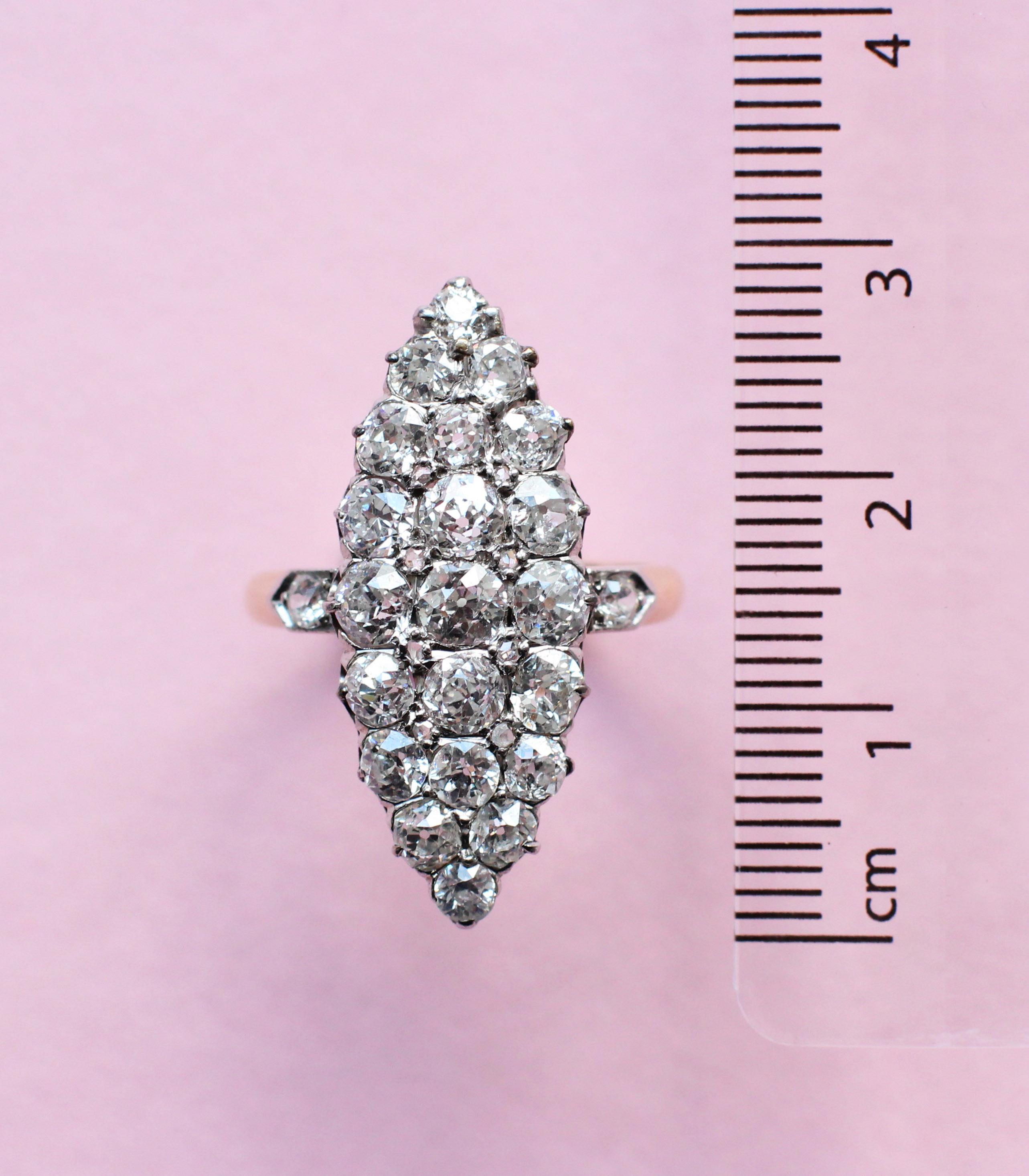 vintage style white diamond cluster navette ring