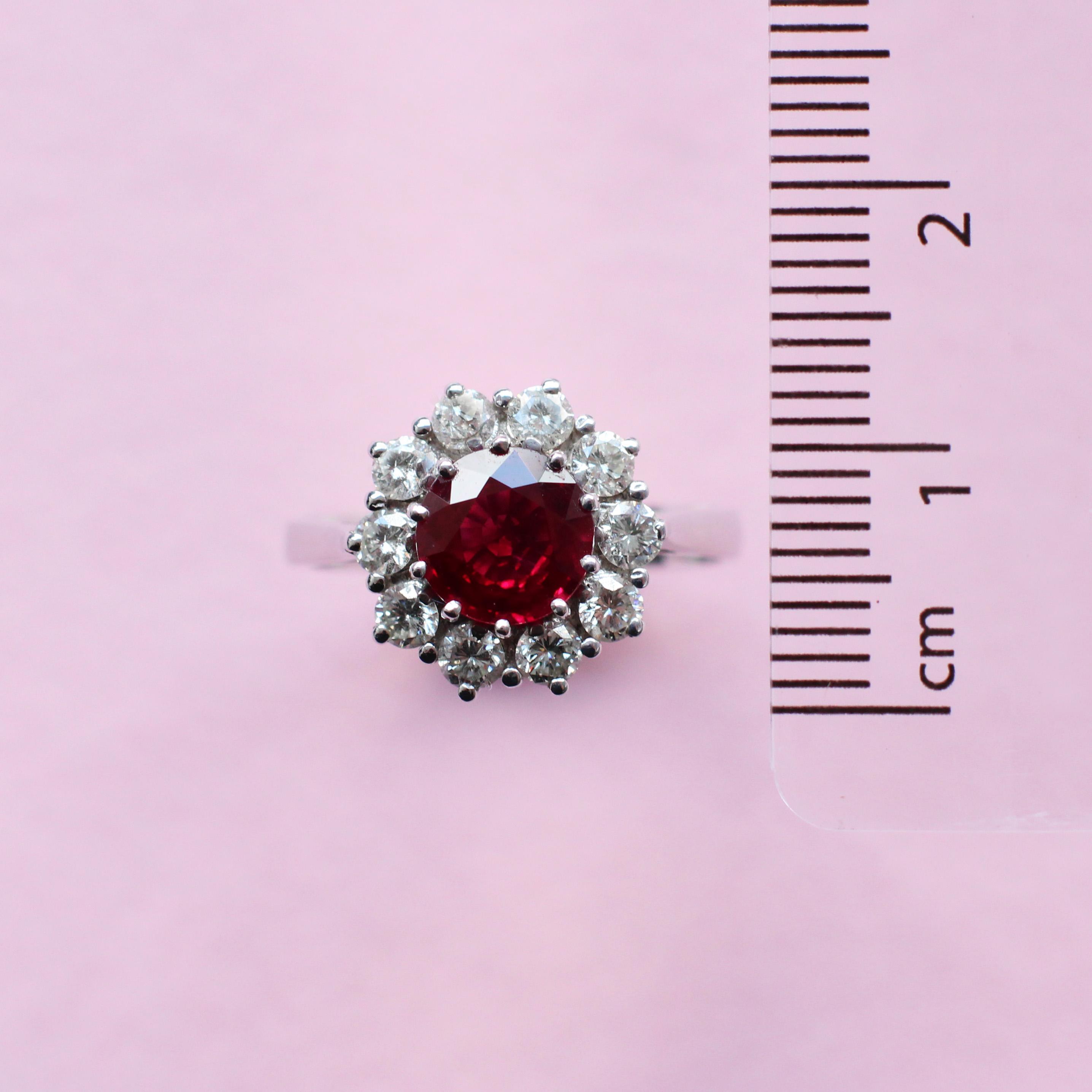round ruby, white diamond surround and white gold ring