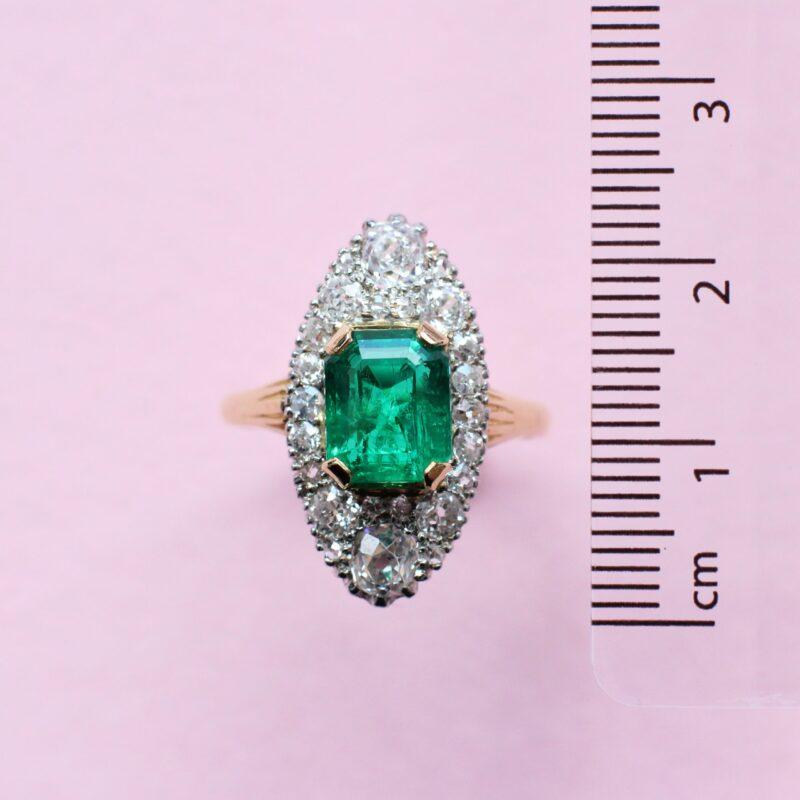 unique yellow gold emerald ring with white diamonds
