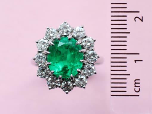 oval emerald, white diamond surround and white gold ring