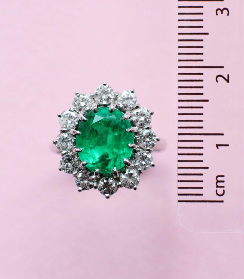 breathtaking emerald ring with white diamond halo