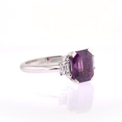 extraordinary purple sapphire trilogy ring with diamonds