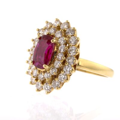 vintage style pinkish-red ruby and white diamond cluster ring
