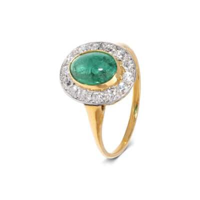 cabochon emerald ring with striking white diamond surround
