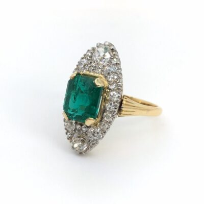 unique yellow gold emerald ring with white diamonds
