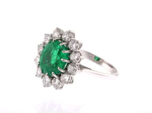 oval emerald, white diamond surround and white gold ring