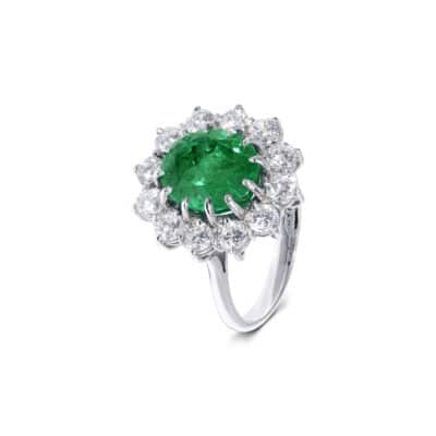 breathtaking emerald ring with white diamond halo