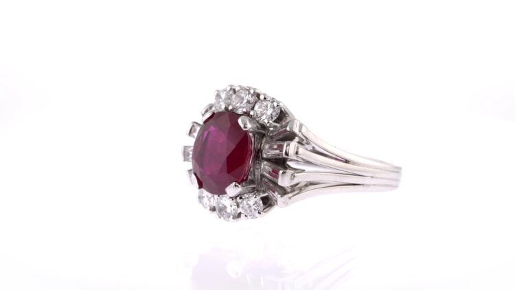 unique red ruby oval ring with white diamond surround