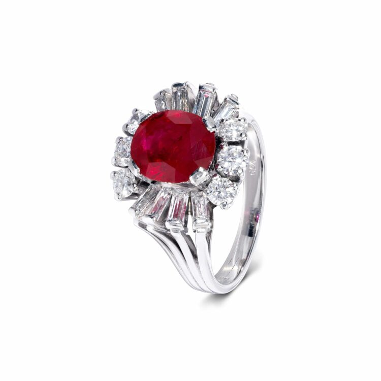 unique red ruby cabochon ring with white diamond surround