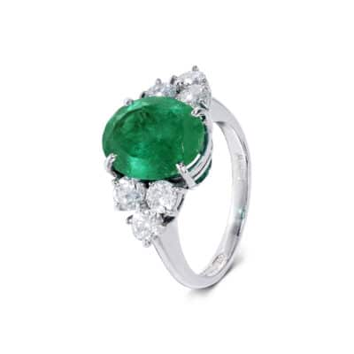 one-off white gold emerald ring with diamond detail