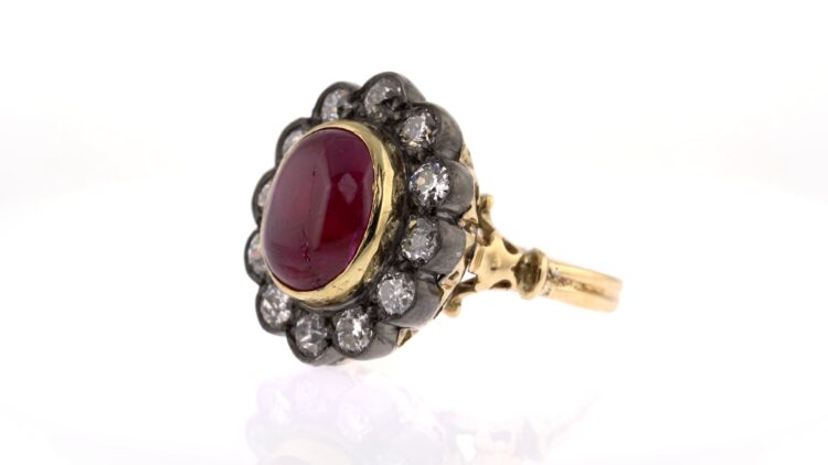 exquisite ruby cabochon ring with diamond halo