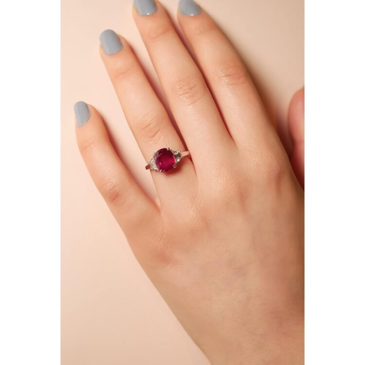 vivid red ruby trilogy ring with white diamond detail