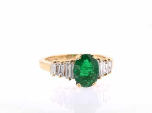 oval emerald and baguette diamond ring