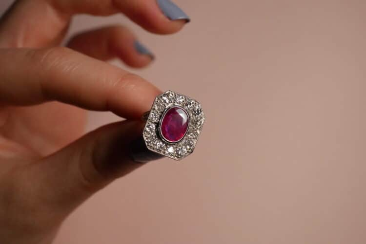 unique pinkish red ruby ring with white diamond surround
