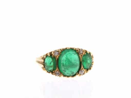 emerald cabochon three stone ring