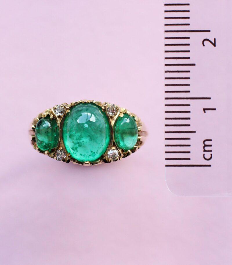 unique cabochon emerald ring with diamond detail