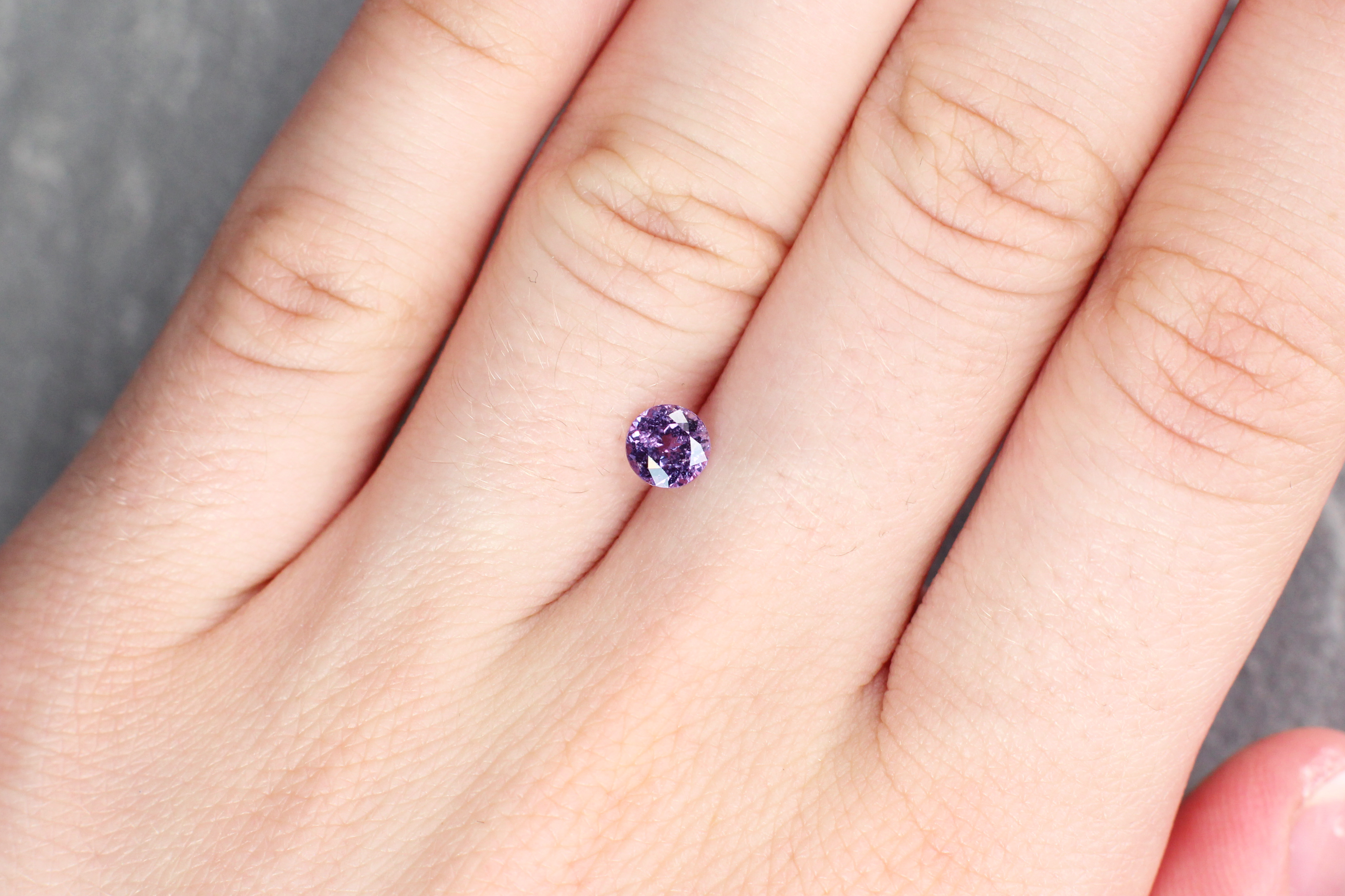 0.78 ct purple round sapphire
