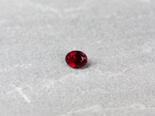 0.57 ct red cushion ruby