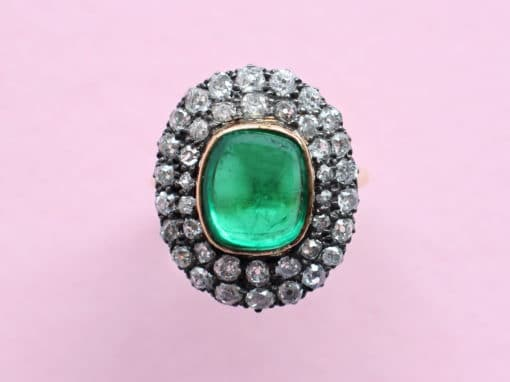 emerald cabochon and diamond surround ring