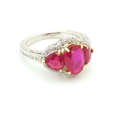 spectacular red ruby and diamond three-stone ring