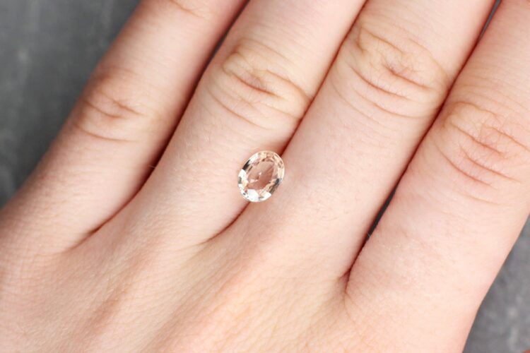 1.33 ct orangy pink oval sapphire
