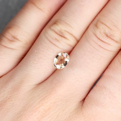 1.45 ct orangy pink oval sapphire