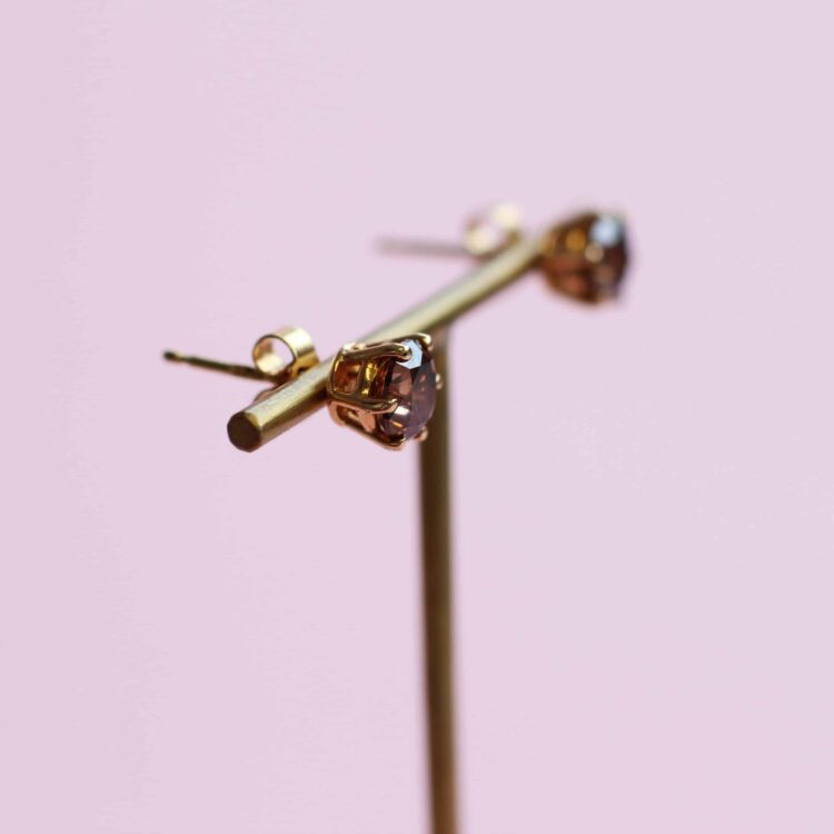 striking brown diamond and yellow gold stud earrings